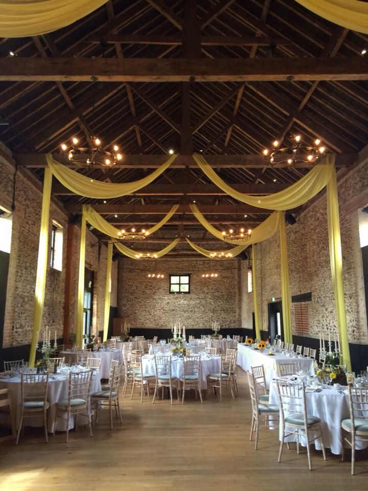 Yellow draping in The Granary Barn #granarybarns #granaryestates #elizabethhalleventstylist #yellowdrapes #barnwedding #countywedding