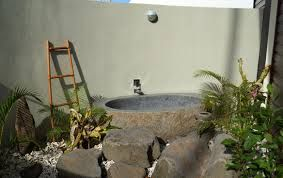 The stunning outdoor bathroom of the Matai Villa Suite - not only features an outdoor shower but a large outdoor tub