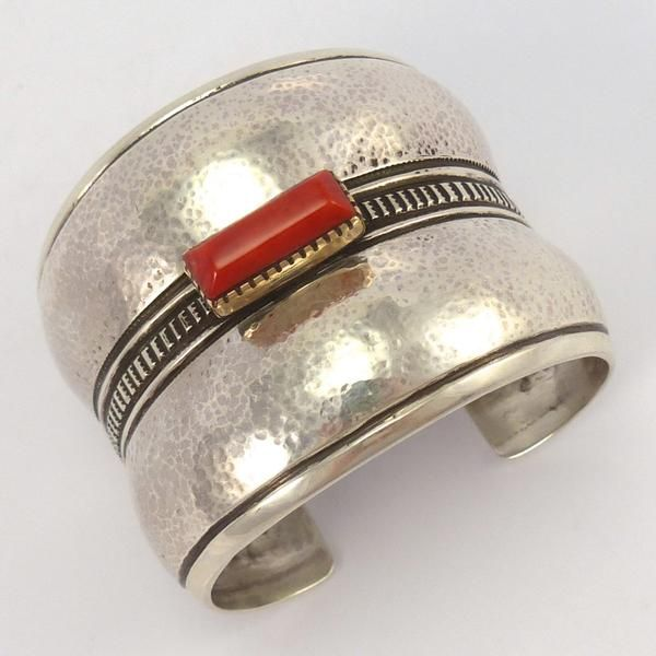 "Wide Sterling Silver Cuff Bracelet with a Hand Hammered Convex Shape, Hand Stamped Designs, and with Mediterranean Coral set in a 14k Gold Bezel. 2.125"" Cuff Width 5.5"" Inside Measurement, plus 1"" ope"