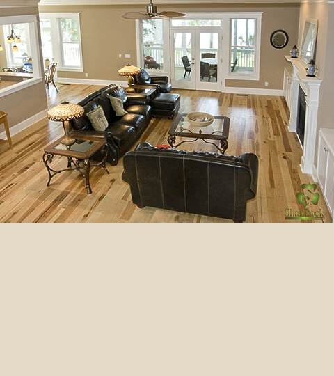 Beautiful hickory floor in this living room. Love it with the dark furniture