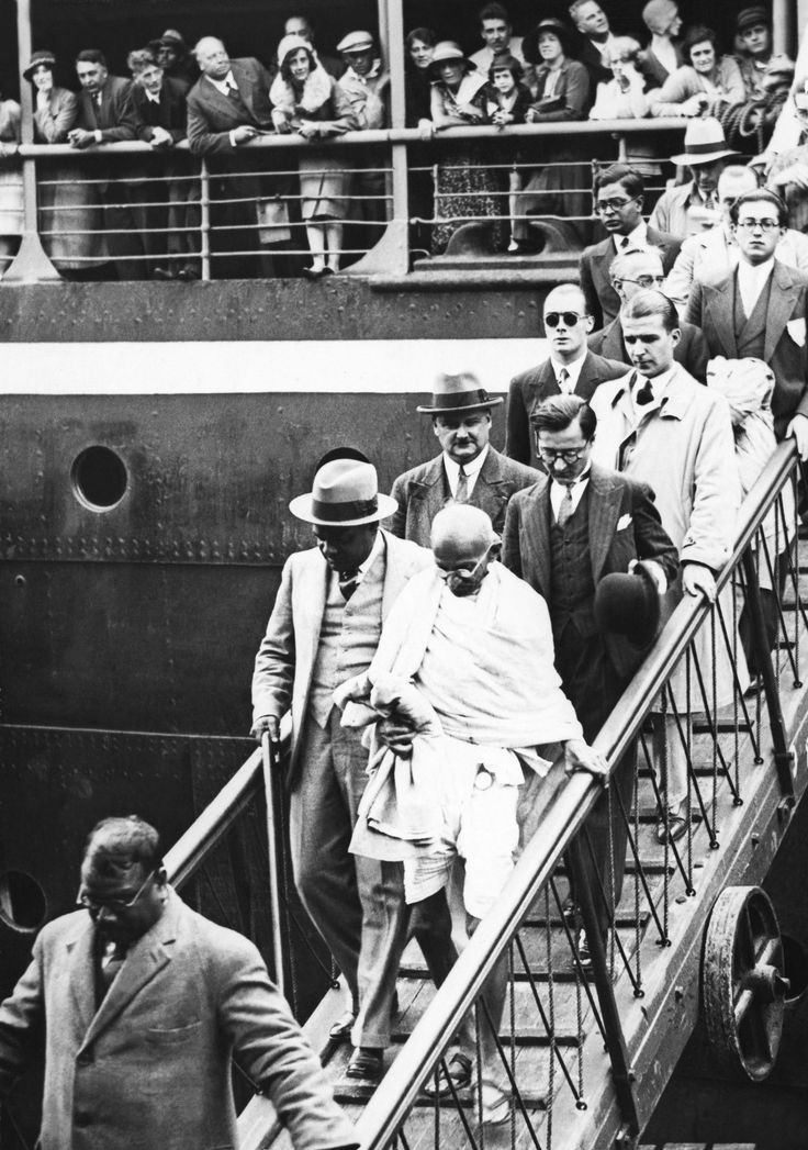 Mahatma Gandhi disembarking a ship during the 1930s.