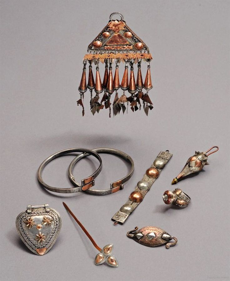 Indonesia ~ Gayo Alas (southern border of Aceh) | Triangular hair ornament, Modesty plate, leg bands, bracelet, hairpin, men's ring, clasp, bead | The Gayo Alas had a special affection for objects made from a combination of silver and suasa (an alloy of gold and copper) ||| Source; Ethnic Jewellery from Indonesia: Continuity and Evolution. Bruce W Carpenter. Pg 61