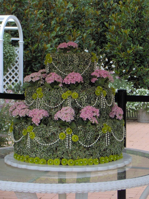 Topiary Wedding Cake | Flickr - Photo Sharing! I like this idea for a garden party.  Could also be placed on a birdbath stand at an entryway.