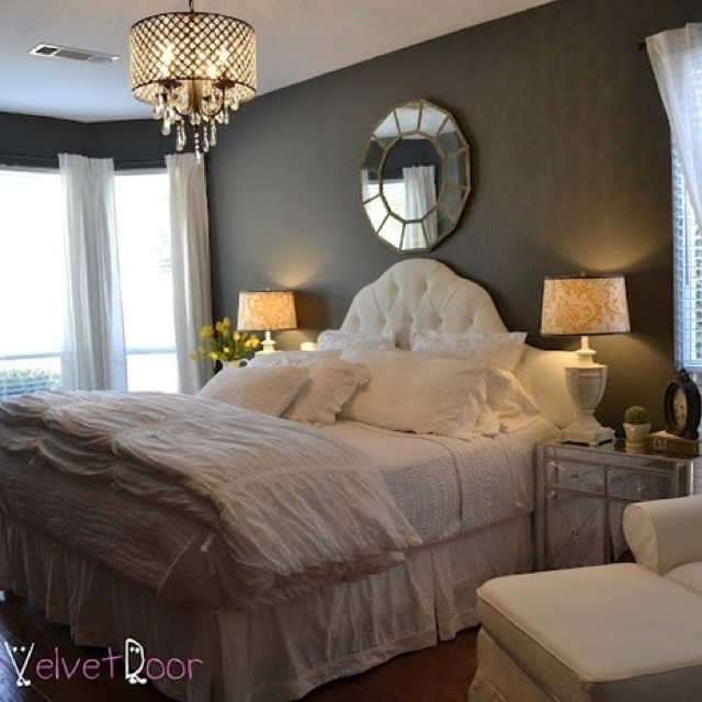 Charcoal gray bedroom walls with white bedding.