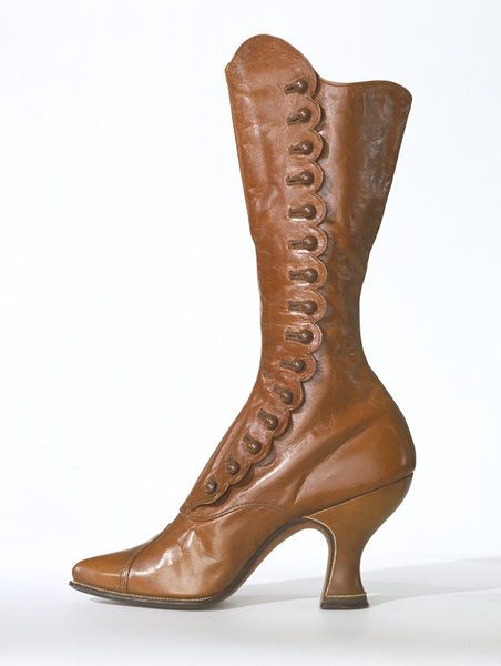 High-heeled buttoned leather boots, 1895-1915. Made in Vienna, sold in London. Glacé kid leather, lined in cotton sateen and silk satin. V & A Museum.