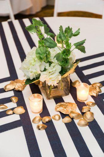 navy stripe runner, nautical centerpiece ideas from nautical navy Virginia Tides Inn Wedding with crab wedding details