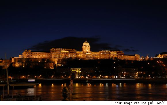 Buda Castle  Location: Budapest, Hungary   Nearest airport: Budapest Airport   Year originally built: 1265   Inhabitants: Hungarian Kings   Interesting fact: You can visit a portion of the 6 mile subterranean labyrinth under Buda Castle.