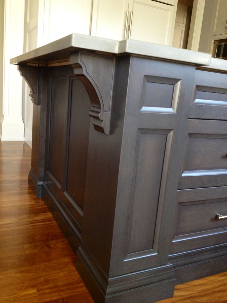 Option for the pass through into family room. Dark gray stained maple cabinetry for kitchen island