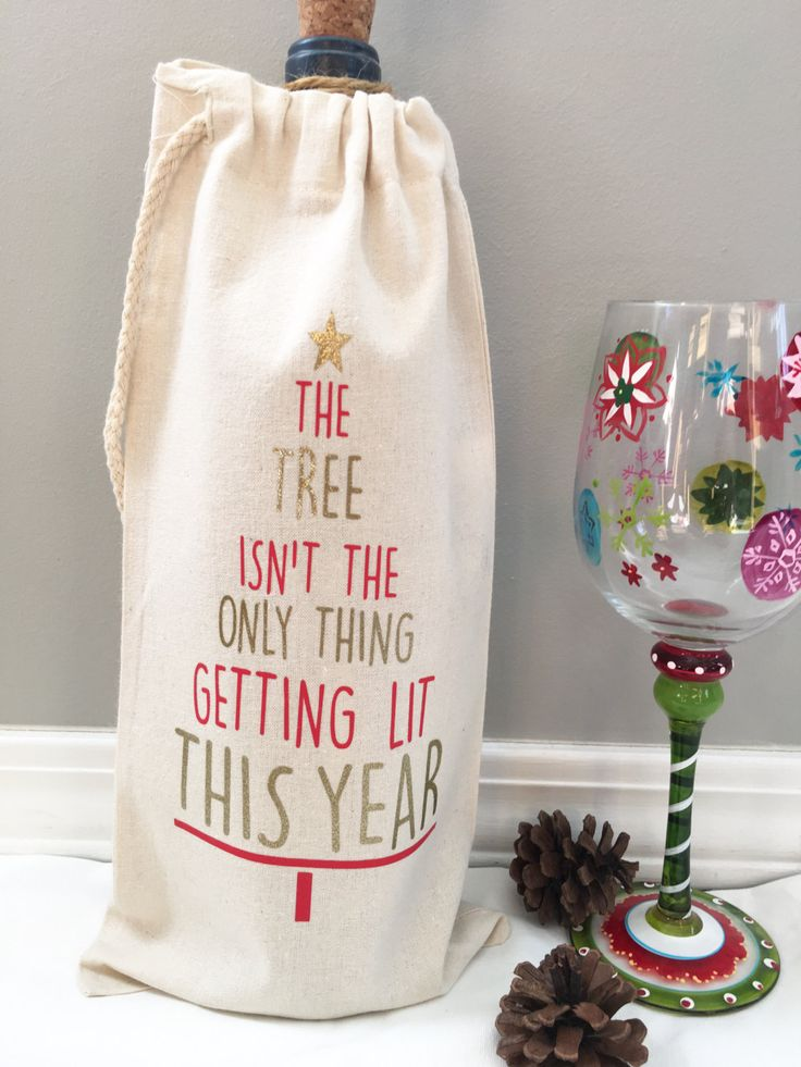 The Tree Isn't the Only Thing Getting Lit This Year bag, Christmas Wine bag, Holidays, Christmas Gift, Wine bag, Wine Label, Table runner by RightHereatHome on Etsy https://www.etsy.com/listing/492469045/the-tree-isnt-the-only-thing-getting-lit