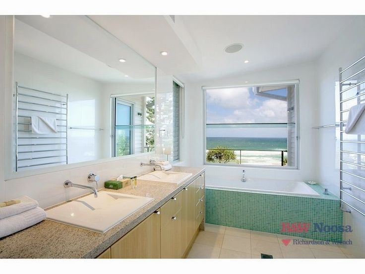 Gaze out at the ocean from this stylish tub #bathroom #oceanview