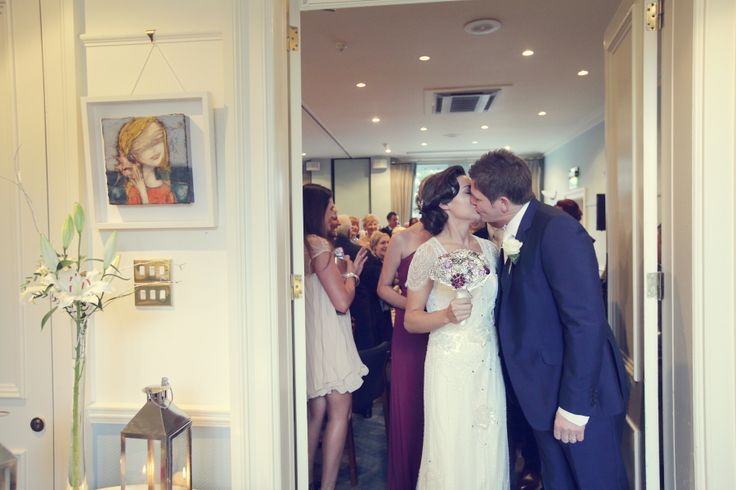 Couple kissing after the ceremony