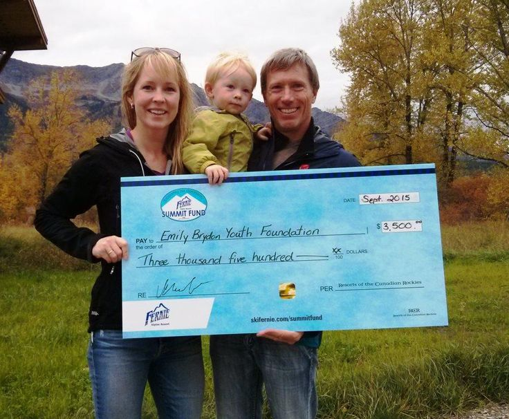 Kelly VanderBeek (retired athlete Canadian national ski team) and her husband David Ford (5 time Olympic kayaker) with their son. Friends of Emily Brydon's receiving our cheque from the Fernie Summit Fund supporting the Emily Brydon Youth Foundation.