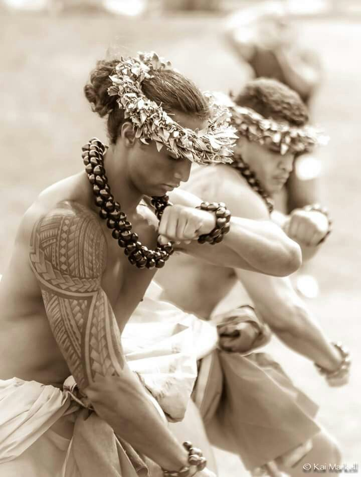 Kane (men) dancing hula kahiko (ancient hula). Photo by Kai Markell of Honolulu, Hawai'i.