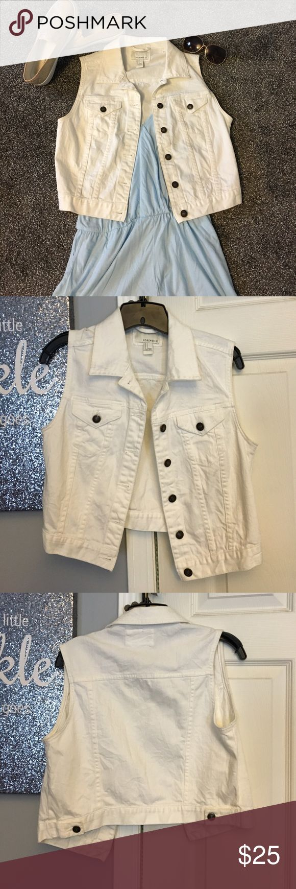 White denim vest Used a few times, good condition, too small for me but modeled for reference, lighter weight denim material, open to reasonable offers, no trades🎀 Forever 21 Jackets & Coats Vests