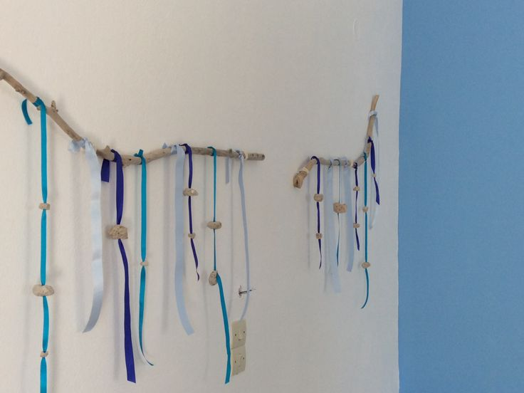 bed wall: stones and colored ribbons