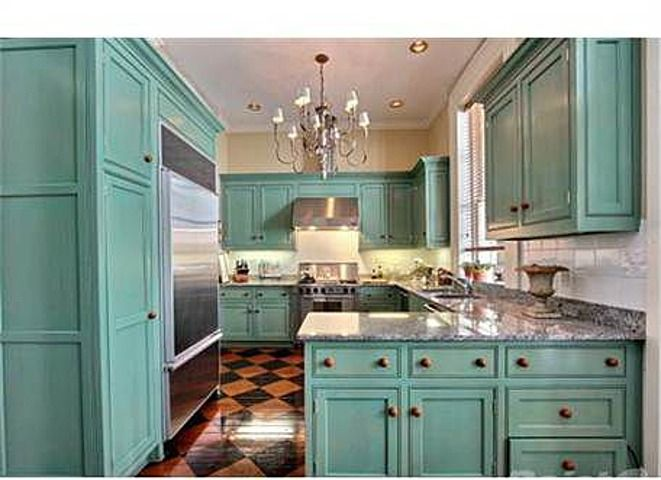 This kitchen is amazing!!! Turquoise painted cabinets