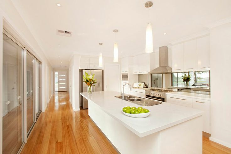 Mirrored glass splash back gives more depth - easy to clean!