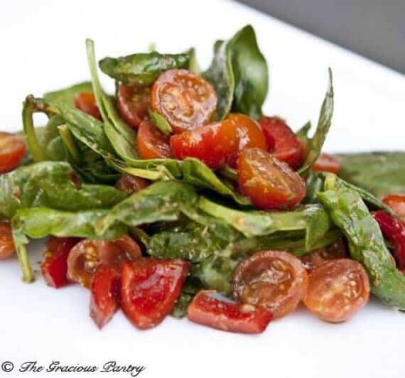 Clean Eating Spinach Salad with Pesto Dressing is a fabulously flavorful way to enjoy your daily salad! Enjoy this and more from TheGraciousPantry.com.