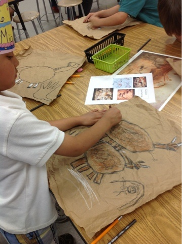 Kindergarten cave paintings! love the paper bag idea, and only sepia tones for crayons/pastels: