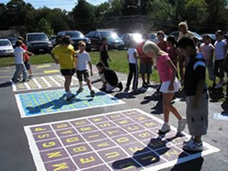 Low cost playgrounds markings, learning while playing