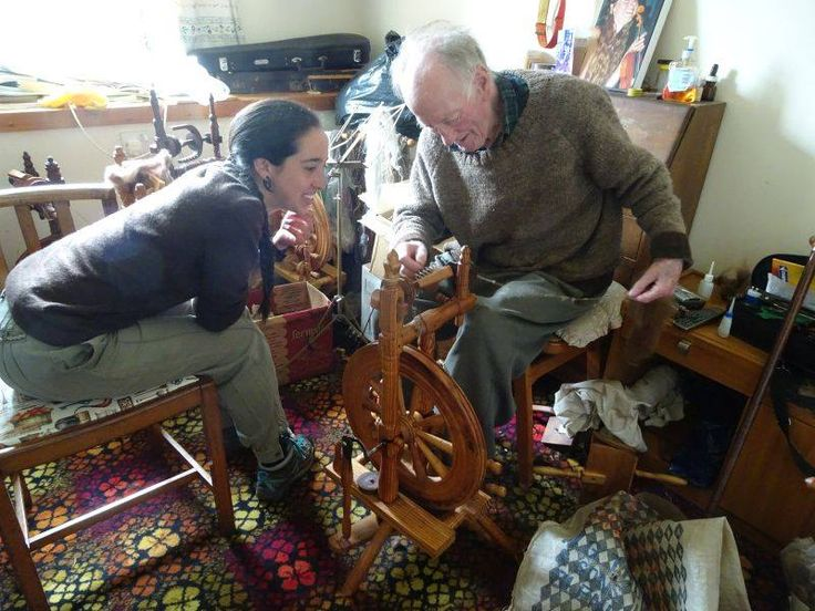 """My friend Jane says: """"Thick mist today, so visited the islands oldest couple, who have been married 72 years, here Stewart is giving Camilla a spinning lesson, he has made 117 spinning wheels, arrived on island to be an assistant lighthouse keeper in the 1940's"""""""