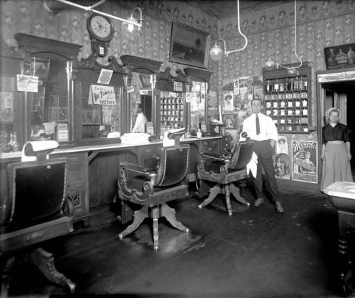 Barber Shop Denver : Interior view of a barber shop in Denver, Colorado; shows a man and ...