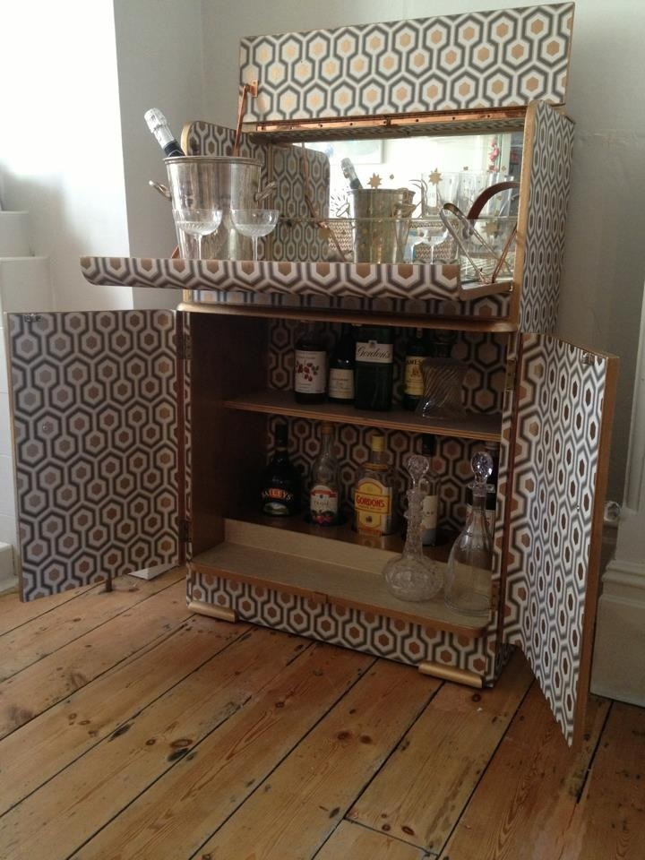vintage cocktail cabinet covered in Cole & Cole & Son Hick's Hexagon paper and trimmed with gold lacquer by www.watkinsandwatkins.co.uk