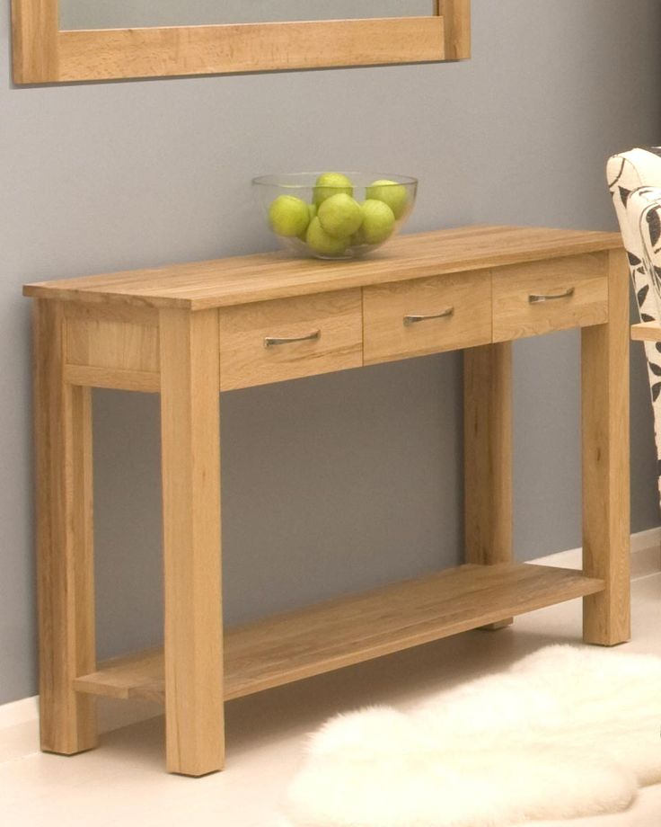 Solid Oak Console Table    This console table is crafted from premier grade, selected solid oak from managed European plantations, combining the warm, classic and resilient nature of oak wood that adds warmth to any room. The console table features a hardwood tongue and groove back, three drawers for storage with dovetailed drawer joints, and panelled sides. Only £279.