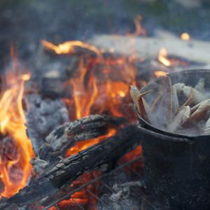 """A tasty outport """"boil-up"""" features salt fish, lassy bread, blackberry cake, jam tart, strong tea and a song or two around a wood fire."""
