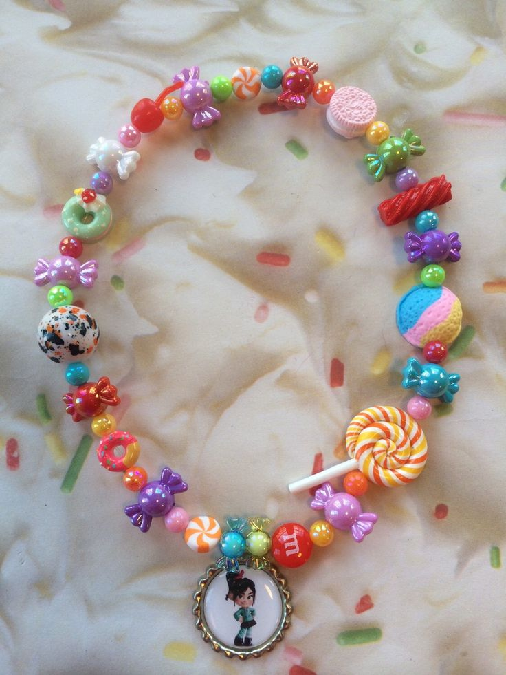 Wreck it Ralph Vanellope Von Schweetz JawBreaker Candy Necklace by GraceandGreenBeans on Etsy https://www.etsy.com/listing/211107182/wreck-it-ralph-vanellope-von-schweetz