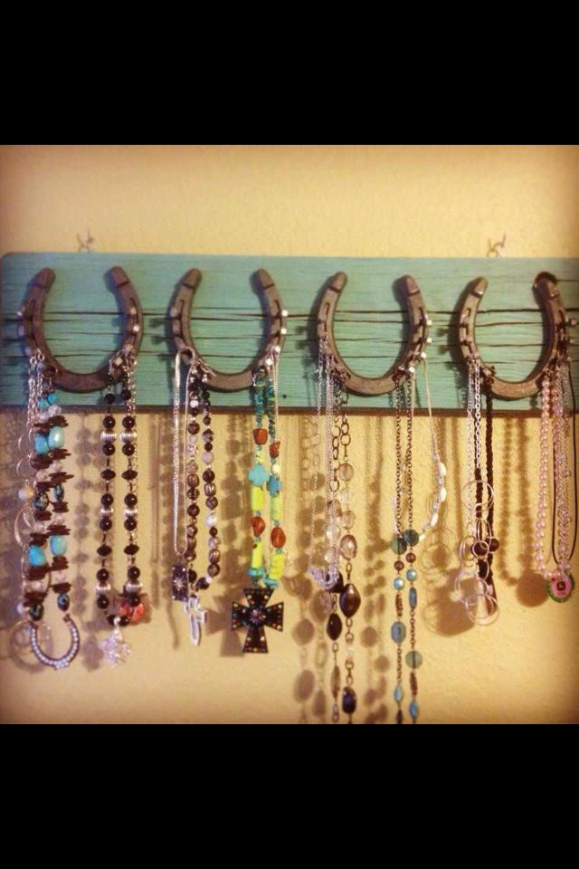 use horseshoes to hang something not necessarily jewelry
