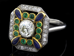 Edwardian Ring: circa 1905 Edwardian period French circa 1905, ladies sapphire diamond and emerald ring. Set in a fine platinum setting with a single transitional cut diamond in the centre, which is surrounded by a single row of gold cut diamonds, emeralds and pear shaped sapphires, all in a milgrain setting