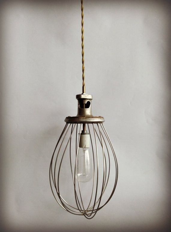 Modern Artifact Decor used a whisk to create a beautiful, rustic-looking light.