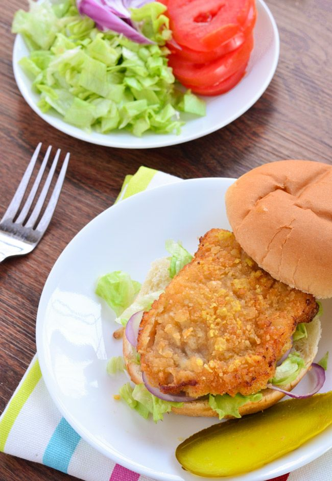 Fried Pork Tenderloin Sandwich soaked in seasoned buttermilk and coated in cracker crumbs.  Yum! - The Spice Kit Recipes