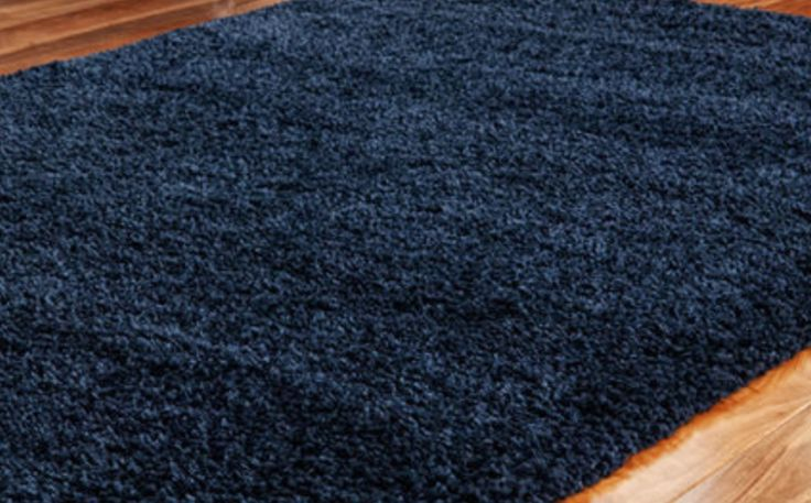 Navy blue shaggy rug for the living room.