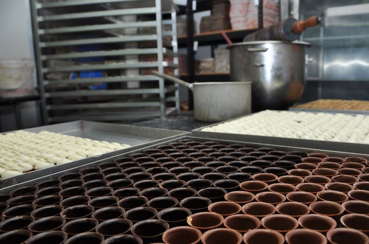 Chocolate cups are filled manually using piping bags. Visit our chocolate factory http://www.lukachocolate.com.au/factory/