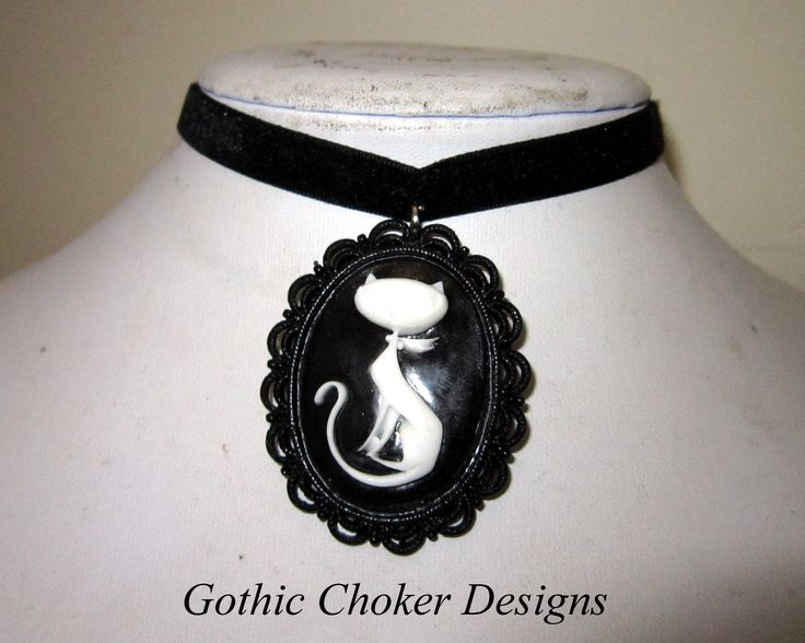 Thin black velvet choker with cat cameo. R120 approx $12. Purchase here: https://hellopretty.co.za/gothic-choker-designs/black-velvet-choker-with-cat-cameo