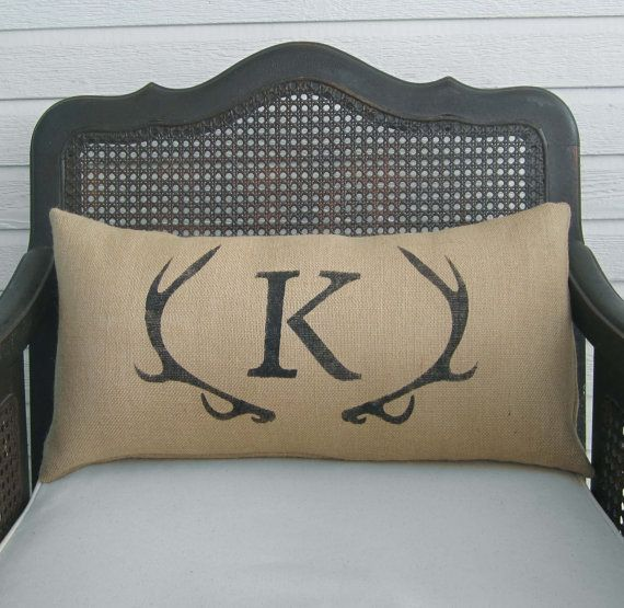 """Available in two sizes 16""""x16"""" or 12""""x24""""  Personalize this antler burlap pillow with the letter of your choice.  Each one of our pillows is made from a high quality burlap fabric. We design and make each stencil and the design is stenciled on the burlap with permanent non-toxic paint. The pillows have an envelope closure on the back.  Please do not hesitate to contact us with any questions."""