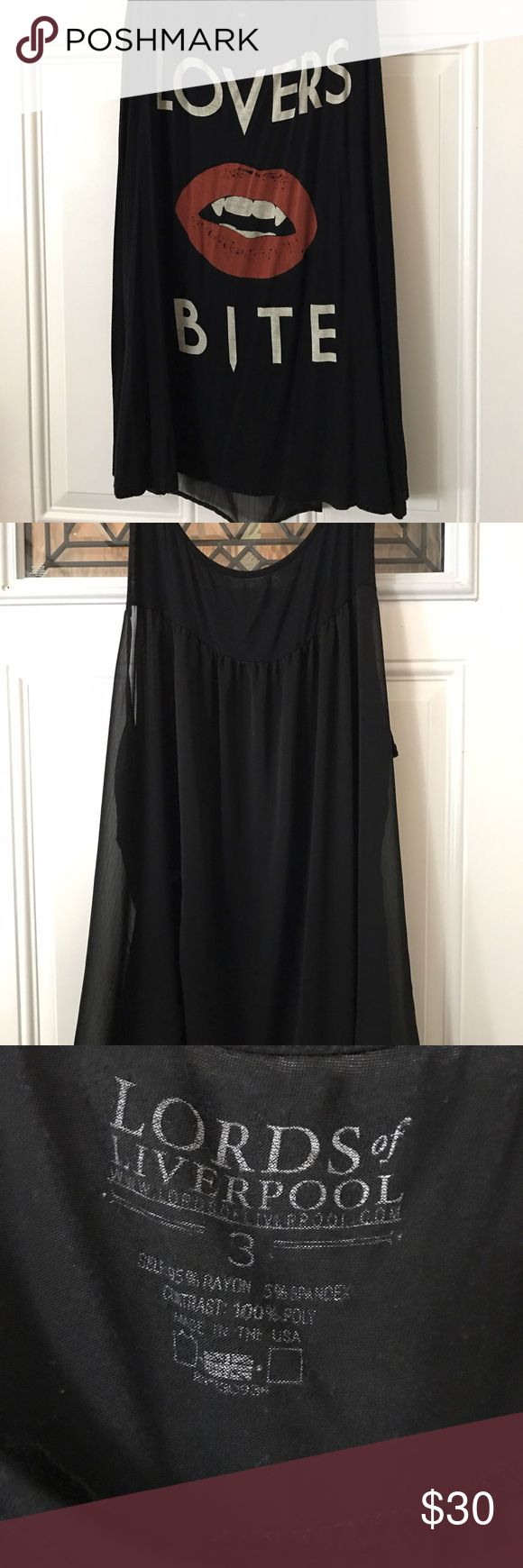 """Black Tang Top Black High Low Tang Top. Says """"Lover's Bite"""". Size 3 from Torrid. Solid Front with Sheer Back. Hits below hip on me, I'm 5'3"""". Lightly warn. No tears or stains. torrid Tops Tank Tops"""