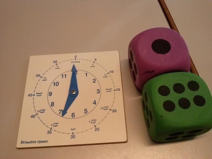 Rekenspellen: klok zetten met dobbelstenen
