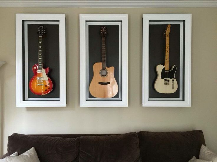 Wall mounted shadow boxes that highlight the art and love of music. These boxes were custom made to size and color to display a personal guitar collection in the home.  http://www.facebook.com/pages/Macwood/1505906669694188