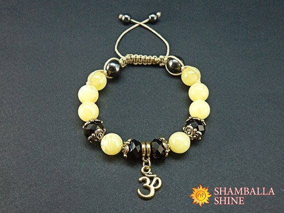 Om meditation bracelet Yellow black jewelry Amber crystal beads Yellow amber bracelet Yoga healing bracelet Gold pendant bracelet Gift for her  This handmade Shamballa bracelet made with three kinds of natural stones – amber, crystal and hematite, complemented by bead caps and gold OM pendant, knotted with beige waxed cord. The cord ends with two hematite beads. These natural gemstones has some healing and magical properties: ♥ AMBER is a stone of health and well-being. This stone carries…