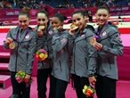 Team USA climb to top step of the podium - London 2012 Olympics
