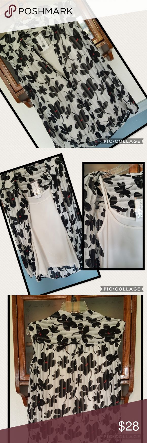 "🆕️🌸PRETTY BLOUSE🌸 Adorable black n white flower pattern blouse, with a white tank. Button up,  sleeveless.  🌸SIZE SMALL  🌸100 % Polyester  🌸ARMPIT TO ARMPIT 19"" 🌸ARMPIT DOWN LENGHT 16 1/2""  💛I love to consider all reasonable offers. 🚫No trades Dress Barn Tops Blouses"