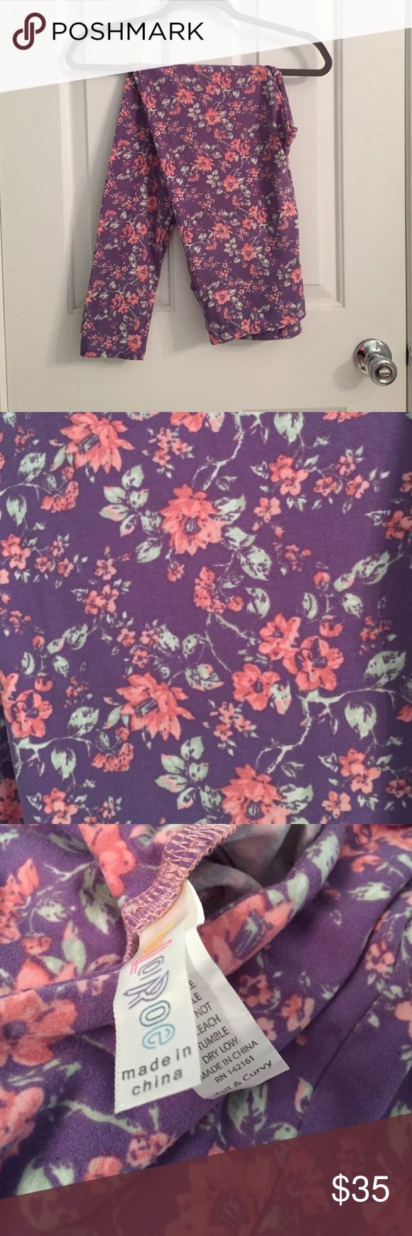 NWT Lularoe TC Leggings NWT Lularoe TC Leggings. Gorgeous pink and green flowers on a purple background. Brand new and buttery soft!! LuLaRoe Pants Leggings