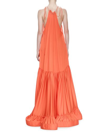 "Stella McCartney plisse chiffon evening gown with metal trim at collar. Approx. 58""L back shoulder to hem. Gathered halter neckline; ties at shoulder. Low-cut arm openings. Tiered, billowy trapeze sil"