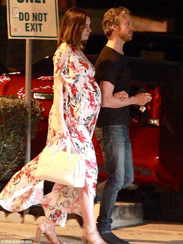 Bumping along: The final stages of pregnancy seemed to be suiting Anne Hathaway down to the ground as she stepped out on a date night with husband Adam Shulman at Lucques in West Hollywood on Thursday