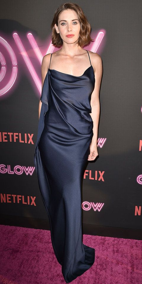 At the of Netflix's GLOW, Alison Brie wore a sexy deep navy satin gown with an asymmetrical pleat and a sky-high slit. The actress went sans jewelry, opting for just a pair of peep toe Christian Louboutins.