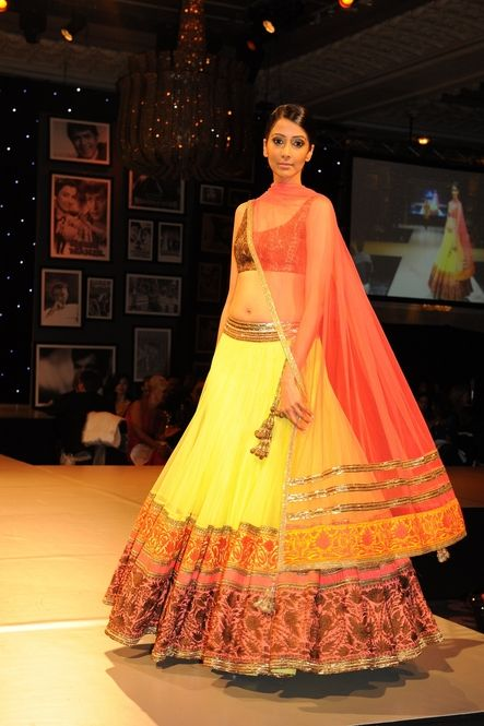 Yellow and orange lengha by Manish Malhotra