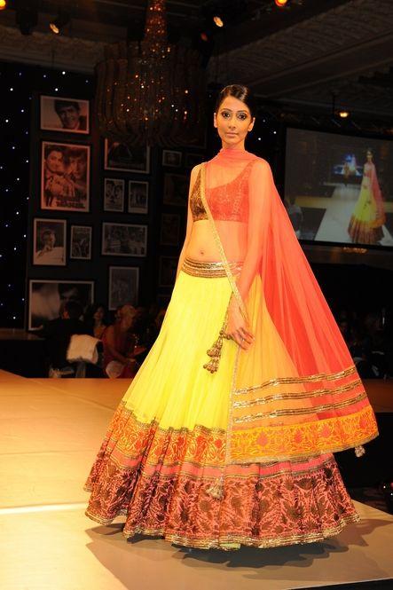 Yellow and orange lengha by Manish Malhotra